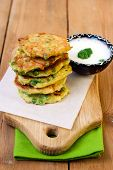 image of patty-cake  - Courgette and pea patties on board with yogurt - JPG