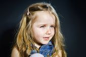 picture of tears  - Crying cute little girl with focus on her tears on dark background - JPG