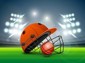foto of cricket  - Red helmet with ball shining in night stadium lights for Cricket sports concept - JPG