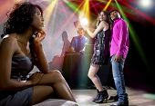 foto of envy  - single black woman jealous of interracial couple on dancefloor - JPG