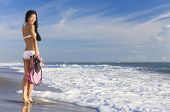 foto of flipper  - Rear view of beautiful young Asian Chinese woman in bikini with snorkel - JPG