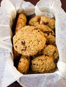 picture of baked raisin cookies  - Whole wheat rosemary cookies with raisin in a box - JPG