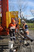 picture of work crew  - Drilling crewmen prepare to remove a core sample from a rig drilling near Greymouth New Zealand - JPG