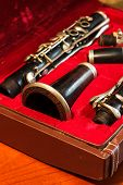 image of clarinet  - clarinet wind instrument disassembled and placed in the case - JPG