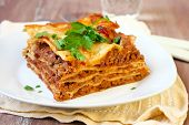picture of lasagna  - Piece of homemade lasagna served selective focus