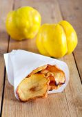 picture of crisps  - Quince crisps on wooden table selective focus - JPG