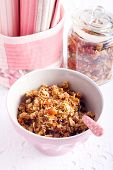 stock photo of apricot  - Homemade granola with apricots nuts and cranberry in a bowl - JPG