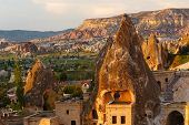 image of chimney rock  - Hotel rooms cut down in the rock in the light of the setting sun - JPG
