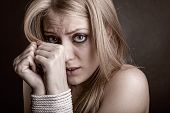 picture of shock awe  - The woman victim of domestic violence and abuse against a dark background - JPG