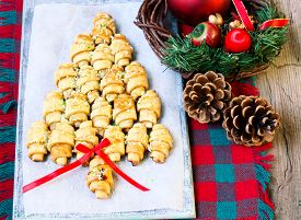foto of crescent-shaped  - Cinnamon crescents shaped and decorated like Christmas tree - JPG