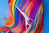 image of wig  - scissors with color wig on a blue background - JPG