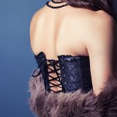image of corset  - woman wearing corset and fur in retro style - JPG