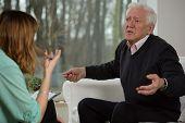 foto of psychological  - Psychological interview with elderly man - JPG