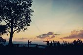 picture of parkour  - Beautiful silhouette tourist having fun at sunset timeVintage Effect - JPG