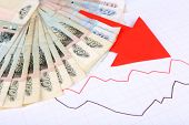 picture of paycheck  - Money and red arrow on graph document close up - JPG