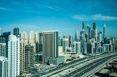 stock photo of dubai  - A skyline panoramic view of Dubai Marina showing the Marina and Jumeirah Beach Residence - JPG