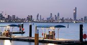 stock photo of kuwait  - Kuwait City skyline with 372 m high The Liberation Tower which contains a revolving restaurant - JPG
