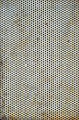 pic of tile cladding  - Old rusted perforated metal sheet background texture - JPG