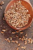 picture of flax seed oil  - Flax seeds in a timber spoon closeup shot - JPG