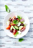 picture of kalamata olives  - Bowl of colorful summer salad with feta and olives - JPG