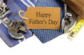 stock photo of tied  - Happy Fathers Day gift tag with border of tools and ties against white - JPG