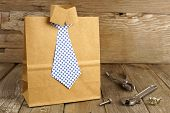 pic of gift wrapped  - Fathers Day handmade shirt and tie gift bag with tools on a wood background - JPG