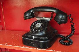 foto of phone-booth  - close up shot of black old style telephone set with rotary dial - JPG
