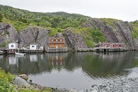 foto of hamlet  - Cliff hugging fishing hamlet by the Atlantic Ocean in Newfoundland Canada - JPG