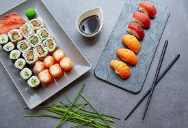 stock photo of soy sauce  - Sushi Maki and Niguiri California roll soy sauce and wasabi - JPG