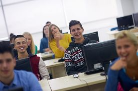 stock photo of classroom  - technology students group in computer lab classroom - JPG