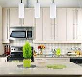 pic of light fixture  - Modern kitchen interior with natural stone countertop - JPG