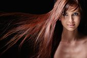 picture of beautiful face  - Beautiful girl with flowing hair on a black background - JPG