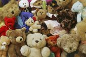 image of teddy-bear  - teddy bears laying in a pile in a child - JPG
