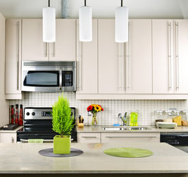 foto of light fixture  - Modern kitchen interior with natural stone countertop - JPG
