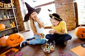 Sweets For Us! Treat Or Trick! Very Cheerful Excited Small Kids In Carnival Head Wear, With Colorful poster