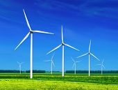 stock photo of global-warming  - green meadow with Wind turbines generating electricity - JPG
