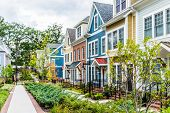 Row Of Colorful, Red, Yellow, Blue, White, Green Painted Residential Townhouses, Homes, Houses With poster