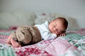 Beautiful Little Newborn Baby Boy, Dressed As Little Gentlemen, Sleeping In Bed poster