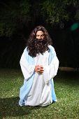 stock photo of gethsemane  - Jesus on knees praying earnestly in the Garden of Gethsemane - JPG