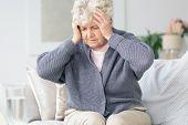 Elderly Woman Having Migraine Headache poster