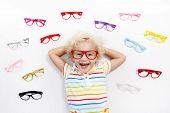 Child At Eye Sight Test. Kid At Optitian. Eyewear For Kids. poster