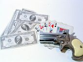 image of derringer  - four king card hand with a derringer on top and money - JPG