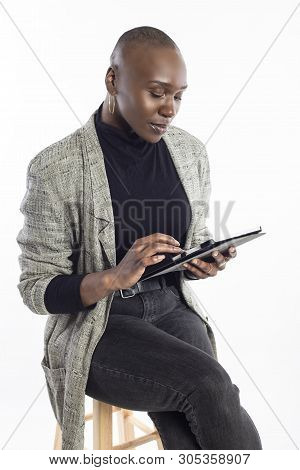 poster of Black African American Female Teacher Preparing Her Course Or Lessons Online With A Tablet Computer.
