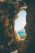 Rock Climber Climbs Into The Cave. Rock In The Form Of An Arch. The Woman Trains On A Natural Terrai poster