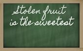 Expression -  Stolen Fruit Is The Sweetest - Written On A School Blackboard With Chalk