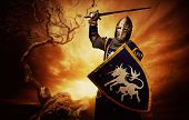 stock photo of knights  - Medieval knight over stormy sky - JPG