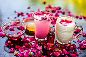 Popular Ramazan Drink I.e. Rose Falooda Or Rose Shake In A Transparent Glass Along With Raw Milk In poster