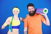 Exercising Together Is Fun. Healthy Lifestyle Concept. Man And Woman Exercising With Yoga Mat And Ju poster