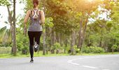 Young Fitness Sport Woman Running On The Road In The Morning, Young Fitness Sportswoman Runner Runni poster