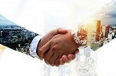 Partnership. Double Exposure Image Of Investor Business Man Handshake With Partner For Successful Me poster